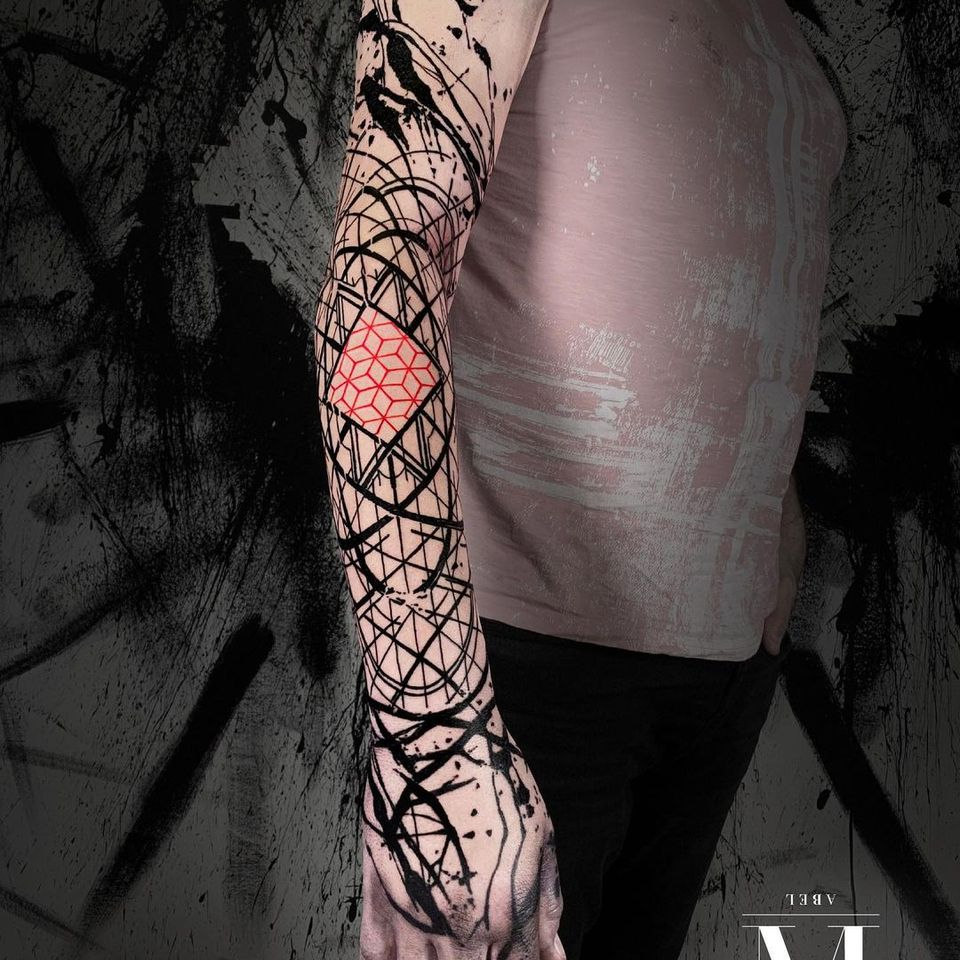Full sleeve tattoo combining abstract and geometric style.