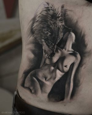 Black and white tattoo of girl with wolf by tattoo artist Alexei Mikhailov @mikhailovtattoo