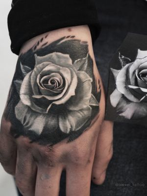 Black and grey realistic rose tattoo by tattoo artist Alexei Mikhailov @mikhailovtattoo