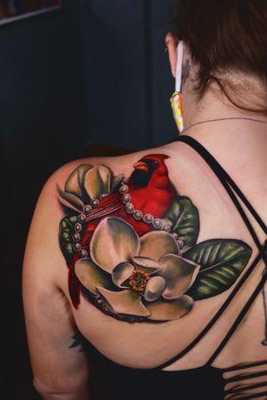Realism cardinal and magnolias