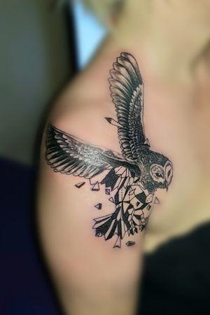 Geometric surrealism owl tattoo