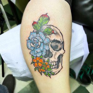 Illustrative skull and flowers.