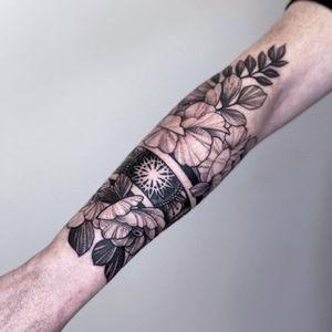 Tattoo by Alena Zozulenko #AlenaZozulenkoo #illustrative #blackandgrey #cuff #wrist #flower #floral #geometric #plant #nature #mandala #sacredgeometry
