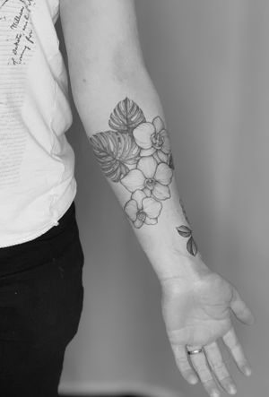 Start of an exotic floral sleeve - orchids and monstera leaves