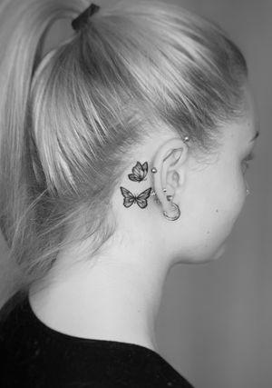 Butterflies behind ear