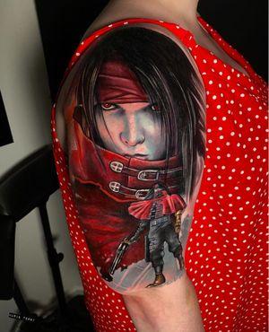 Final Fantasy portrait on outer upper arm.