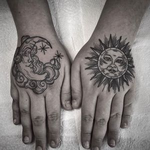 Sun & moon. #handtattoo #hands #sun #moon #black&grey