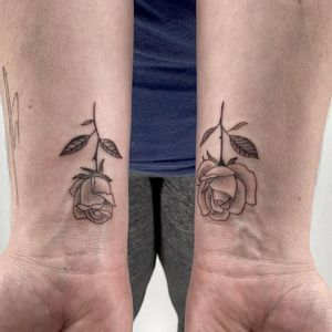 Matching roses. Done by Mario. #roses #matchingtattoos #nyc #wrists #black&grey