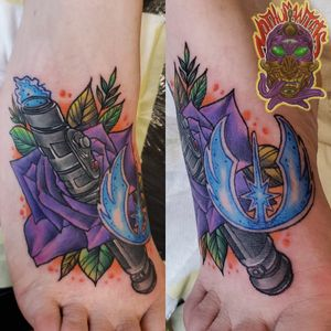 Lightsaber, rose and jedi symbol on the foot
