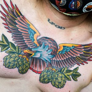 Epic chest eagle with glittery hops.  This is a beer tattoo.