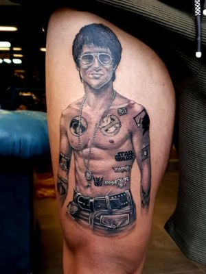 Bruce lee tatted up. 80's series logo's.