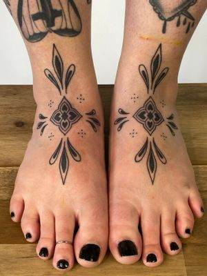 Ornamental symmetrical feet