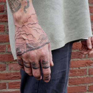 Seascape on the hand #brushtattoo #paintedtattoo #handtattoo #clouds #expressive