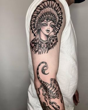 Girl and Scorpion #traditionaltattoos #blackandgrey #scoripiontattoo #armtattoo #traditionalblackandgrey