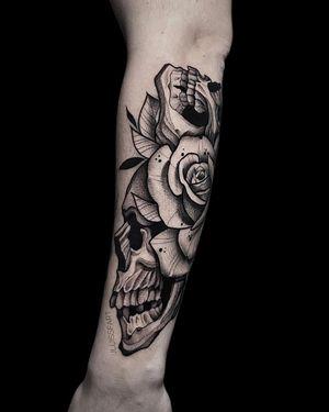 Skull + Flowers #blackandgrey #skulltattoo #armtattoo #flowertattoo