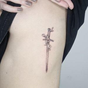 #swordtattoo #ribtattoo #finelinetattoo #fineline