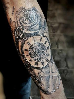 Rose clock cross
