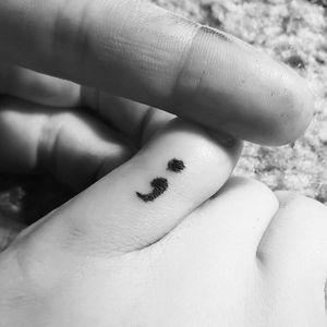 Self tat on left pinky toe