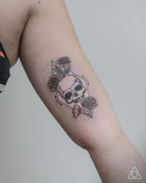 Diamond shaped coffin with skull and marigold flowers