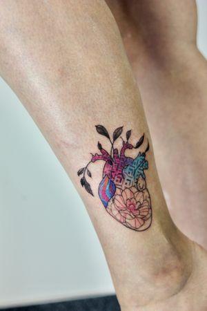 Floral heart tattoo