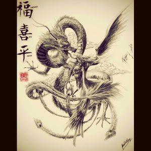 Phoenix fighting a dragon on left arm #sleeve #dreamtattoo #wishlist