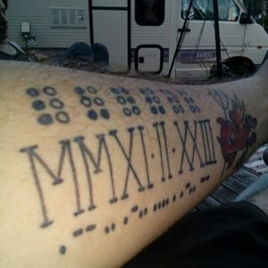 My sons name and date of birth. From top: Name in braille, bithdate in latin numbers, second name i morsecode.