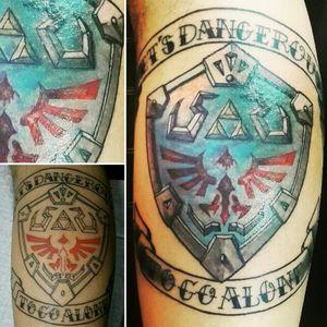 "#HylianShield ""It's Dangerous To Go Alone"" My brother's 2nd tattoo and my favorite work so far!! lml #tattoo #customtattoo #legtattoo #linework #shading #coloring #lettering #geektattoo #videogametattoo #gamertattoo #gamerink #hyruleshield #zeldatattoo #thelegendofzeldatattoo #thelegendofzelda #ilustrativetattoo #CostaRicaTattoo #AndrésPeñaTattoos"