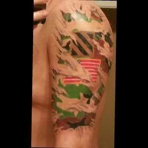 Ripped skin tattoo of my Army fatigue  Uniform with my duty patch and American flag.