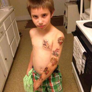 My son rocking his temporary tattoos a few years ago #startedtheaddiction   #futureinkartist  #prouddad