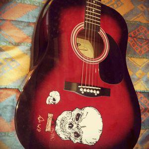 Mon dessin sur ma guitare.