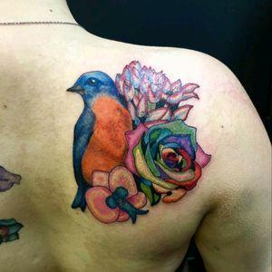 Bluebird on my shoulder! By Allison McEntire at Jaded Angel in Ames, IA. #flower #bird #bluebird #easternbluebird #rainbowroses #rose #orchid #birdandflowers