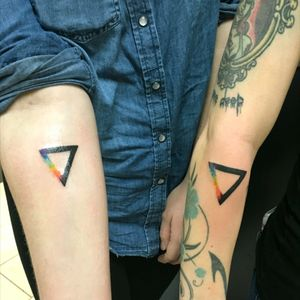Matching watercolor tattoos.
