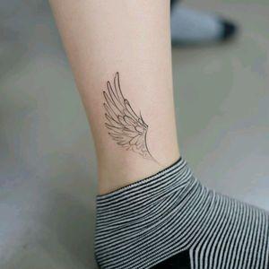 By #tattooistdoy #minimalist #wings #linework #wing #simple