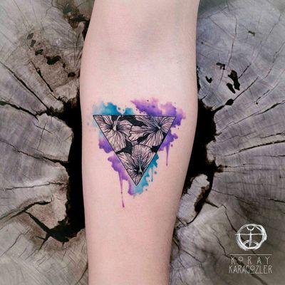 By #koraykaragozler #watercolor #hibiscus #triangle #negativespace #watercolortattoo #flowers
