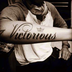 Victorious #letteringtattoo #lettering #valentinetattoos #love #tattooedmen #tattooed