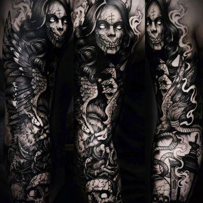 Demon and skulls with wings done in blackwork. A favorite darker piece. #demon #demons #macabre #creepy #skull #blackwork