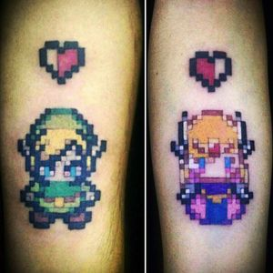Legend of zelda..pixel tattoo Couple tattoo I want yo do more of this..