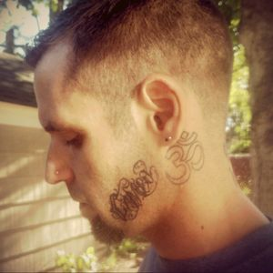 My Dude out back today after a haircut- #MyBoyfriend #om #tattoodudes #inkedboy #scripttattoo #cameo #daughtersname #facetattoos #necktattoos #chackratattoo #spiritual