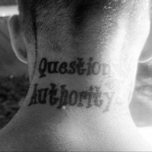 The back of My Man's neck.#MyBoyfriend #inkedboys #questionauthority #rebel #blackworktattoo #quote #script #necktattoo #necktattoos
