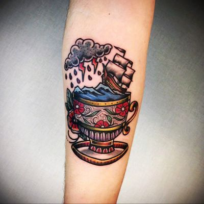My first tattoo made by Yaman Cakir #traditional #teacup #color #cloud #lightning #flowers #sea #storm