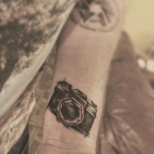 My two photography tattoos