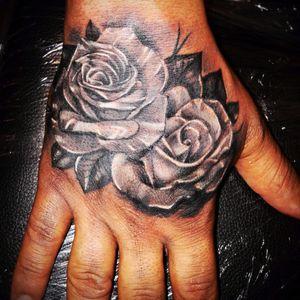 rose hand tattoo by Edina