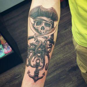 Pirate themed tattoo by Robert Jaggers. #Pirate #Pirateskull #shipwheel #anchor #swords