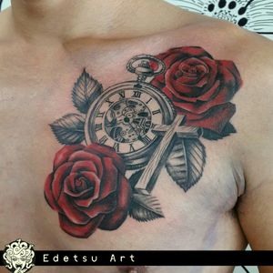 More flowers. Black and grey cross and clock