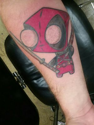 Gir deadpool mix up done by Donald at American tattoo Omaha Nebraska