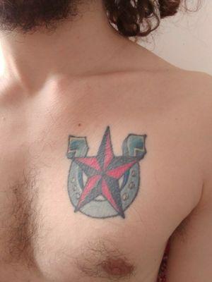 My first ever Tattoo #luckycharm #traditioanal #colortattoo #redink #steelblue #hourseshoe #star