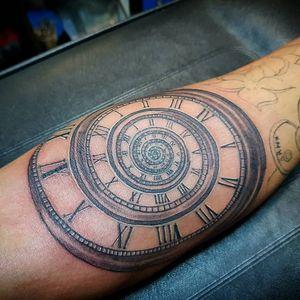 Clock spiral tattoo
