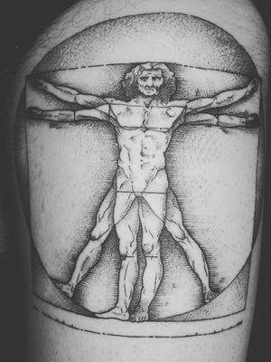 Vitruvian man on the thigh. Done by John Cacic #DaVinciTattoo #vitruvianman #blackwork #linework #thightattoo