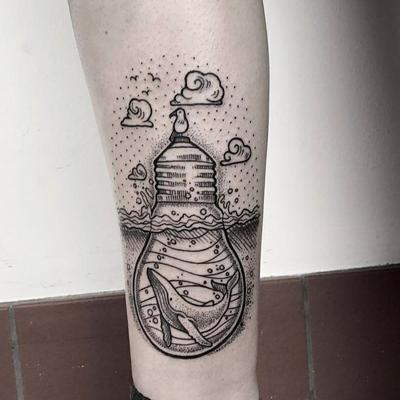 Creative light bulb blackwork tattoo by Maret Lordenstein #lightbulb #creative #oceanlife #wale #sea