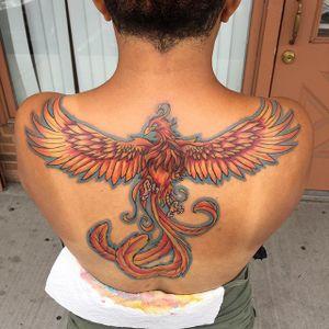 Phoenix tattoo by Anthony Hunter #murdaink3 #murdaink3_ant #murdaink #fire #backtattoo #pheonix #colorful #longislandtattoos #longislandink